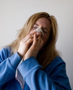 FluVaccines_WomanSneezing