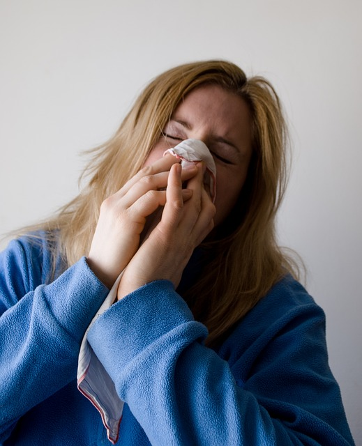 FluVaccines_WomanSneezing