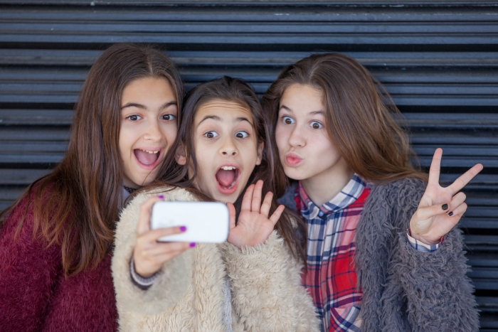 Childrens Medical Group Teenagers with Cell Phones