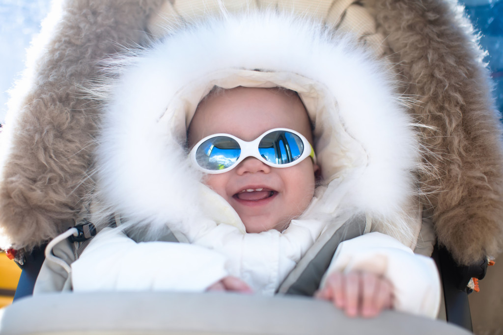 Baby in sunglasses in the winter