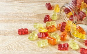 children's vitamins, gummy bear vitamins in a glass bottle.