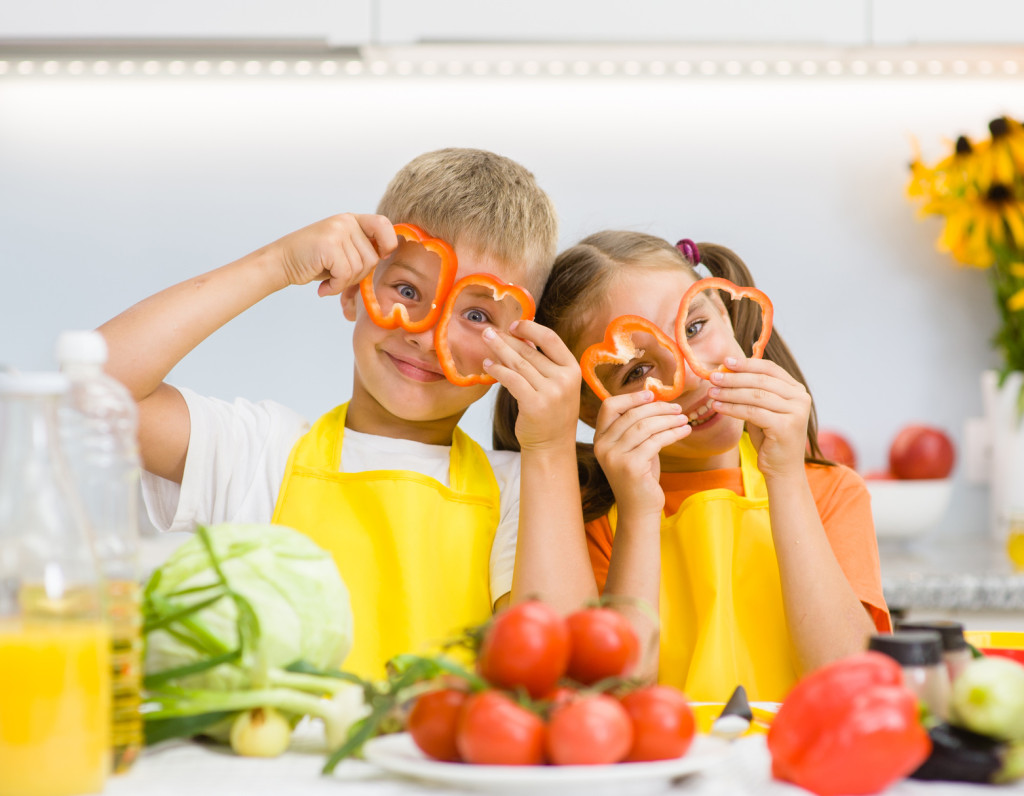 Vegetarian Diet Tips for Children. Kids playing with vegetables.