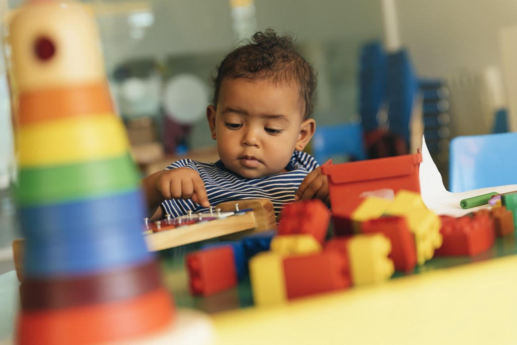 baby playing with toys at daycare